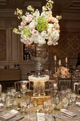 Wedding arrangement of pink rose, white hydrangea, on top of glass vase