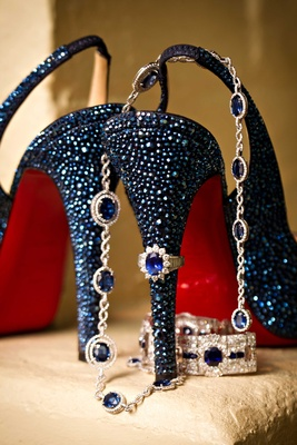 Blue crystal Christian Louboutin slingback wedding heels with red soles and blue sapphire jewelry