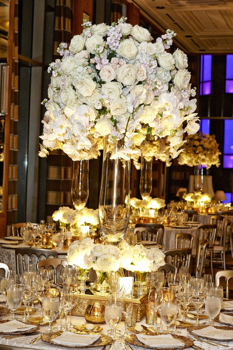 tall white floral centerpieces arrangements gold and white detailing tablescapes