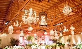 Light fixtures suspended from exposed wood beams