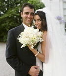 Bride and groom headshot with bouquet