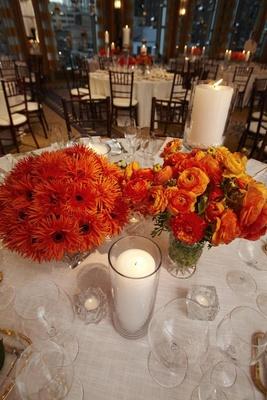 Wedding reception table centerpieces orange flowers