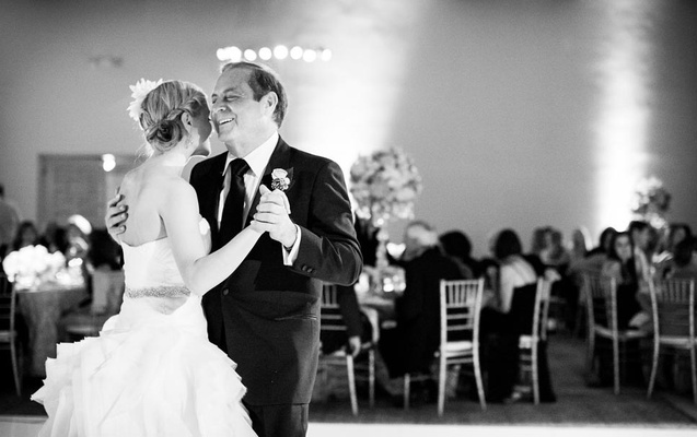 Black and white photo of bride and dad dancing
