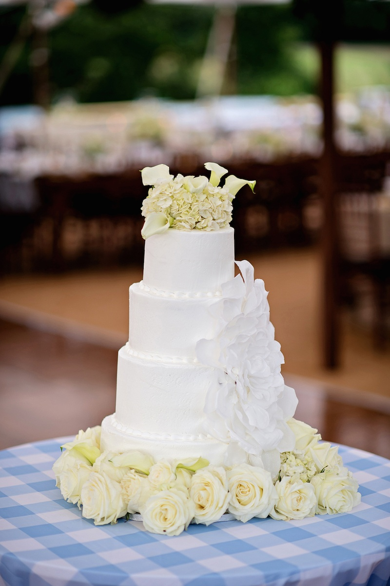 Cakes desserts photos wedding cake with flowers inside weddings white wedding cake with large sugar flower topped with white calla lilies and ivory hydrangeas izmirmasajfo