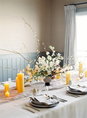 goldenrod pillar candles for bridal shower table, soft color palette, unique floral arrangements