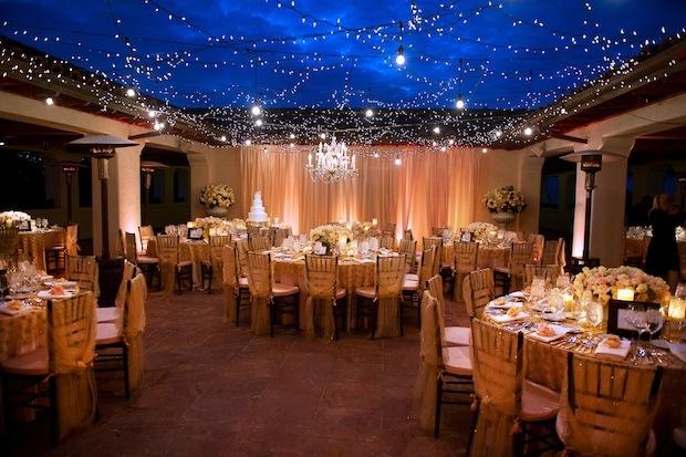 Interior patio wedding with garden-inspired string lighting
