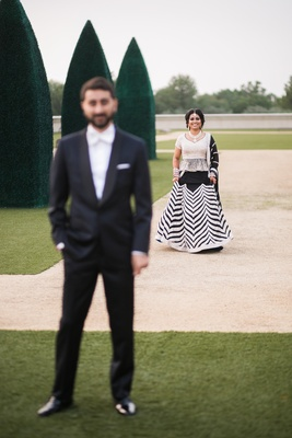 south asian couple in black and white outfit, first look before reception