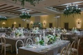 grey linens, white and green wedding reception, greenery chandelier, taper candles