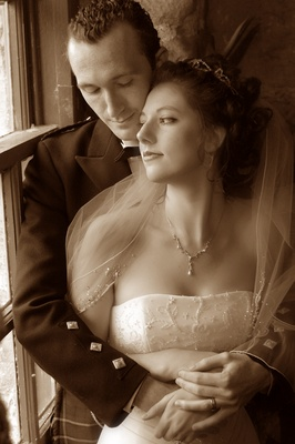 Sepia tone picture of couple in Scotland castle wedding venue