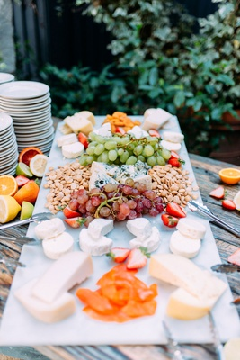 wedding reception cheese plate charcuterie display grapes nuts cheese strawberries