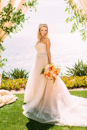 bride under drapery greenery wedding ceremony overlooking ocean custom trish peng wedding dress