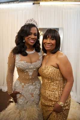 Kandi Burruss's mother in gold sequin dress