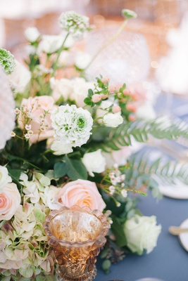 wedding reception blue table linen pink peach white ivory flowers rose hydrangea candle votives