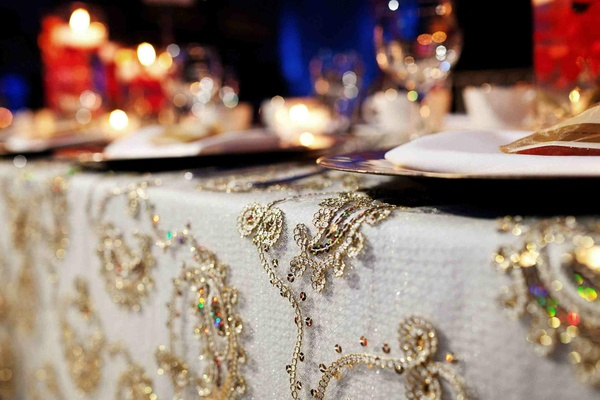 Ivory tablecloth with gold sequin embroidery overlay