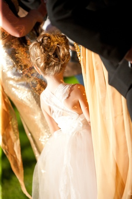 Back of flower girl with lace straps and tulle skirt