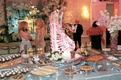 Wedding dessert table decorated with a swan ice sculpture and pink orchid bouquet
