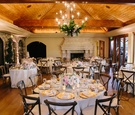 intimate reception space with wooden chairs, floor, ceiling