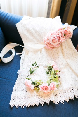 White lace flower girl dress with light pink rose sash and matching flower crown