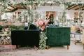 wedding reception lounge boho bohemian design layered rug velvet furniture rattan vintage decor