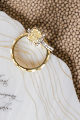 Yellow diamond engagement ring with white diamond halo and setting