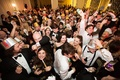 Guests on dance floor with New year's eve party hats noisemakers and horns wedding ideas holiday