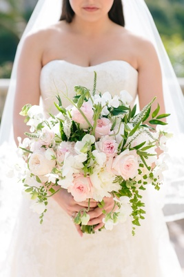 bouquet with pink roses, white freesias, and greenery