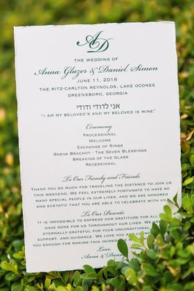 White and green script ceremony program monogram wedding date and letter to family friends parents