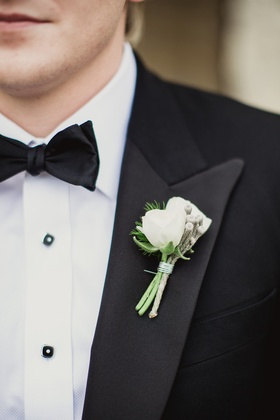 white boutonniere with details on lapel for tuxedo