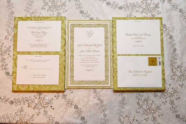Hannah Handmade gatefold wedding invitation with light green brocade, laser-cut details