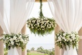 the resort at pelican hill wedding under a rotunda with floral chandelier