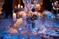 Winter wedding centerpiece with blue lighting and crystals