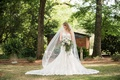 bride in mermaid lace dress with billowing cathedral veil