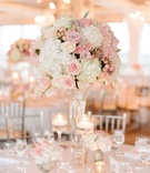 Wedding reception classic decor tall pink and white flower arrangement rose hydrangea gold candles