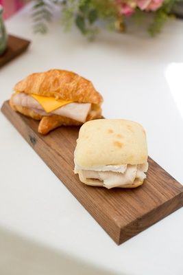 Ham & cheese sandwich on a croissant, turkey & Brie on ciabatta for outdoor wedding shower