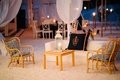 Lounge area at wedding reception on white sand beach under tent on Harbour Island in the Bahamas