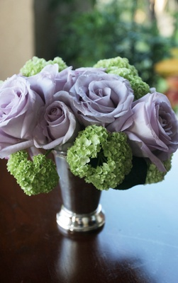 Light purple roses and green hydrangeas in a mint julep cup