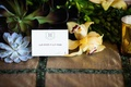 escort card with logo on rustic table