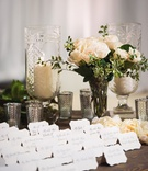 wedding escort cards calligraphy lehr and black silver candle votives white rose on wood table