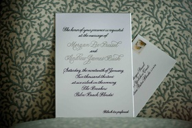 Morgan Pressel wedding invite in silver and purple calligraphy