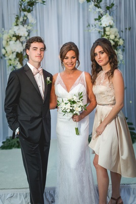 Luann de Lesseps with son Noel and daughter Victoria in high low dress flower girl ring bearer