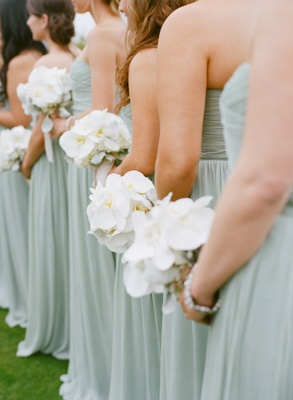 Bridesmaids in blue dresses with phalaenopsis orchid