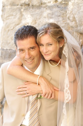 Groom in khaki suit with bride in Vernazza, Italy