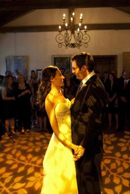 Bride and groom dancing on illuminated floor