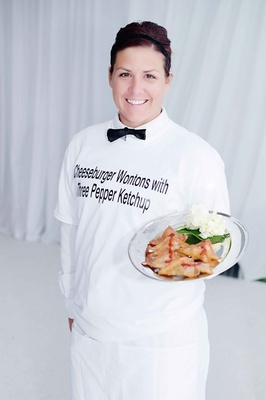 Female catering server with personalized T-shirt and bow tie