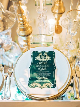 wedding reception mirror table gold charger emerald green and gold die cut menu card monogram crest