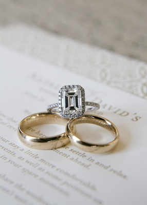 Matching gold wedding bands and halo ring