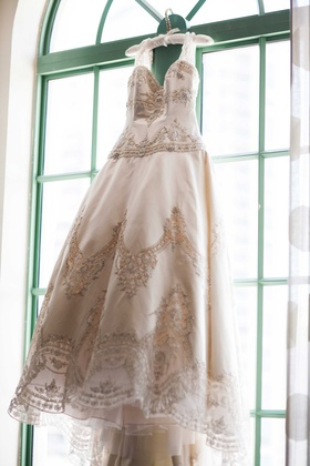 ball gown intricate beaded detail champagne wedding dress eve of milady florida hanging train sleeve