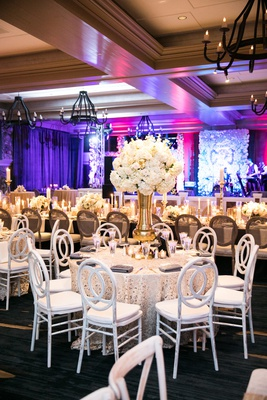 ivory flowers on thick gold vase, textured cream linens, white chairs