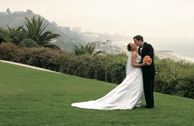 Bride and groom with ocean view