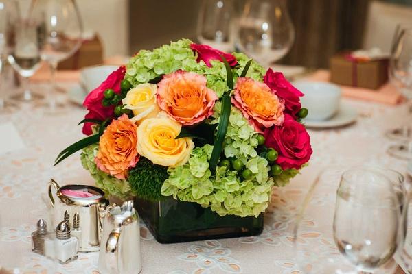 bridal shower centerpiece pink yellow orange rose green hydrangea greenery low centerpiece flowers